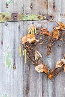 Willow heart wreath decorated with dried Hydrangea flowers and Betula - Birch catkins.