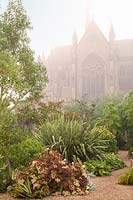 View of misty Cathedral gardens at Arundel Castle, Sussex, UK.
