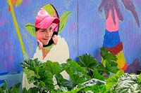 'O Beoley-wan-Kenobi' school show garden, a pupil poses for the camera 
