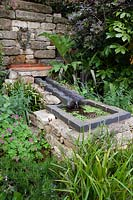 Rill fed by water spout in the permanent garden at Malvern Three Counties Showground, 2017.