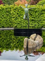 'The Leaf Creative Garden: A Garden of Quiet Contemplation' - view across pond with rock and a sculpture