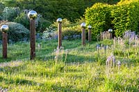 View of meadow with Camassia subsp. leichtlinii and avenue of 