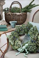 Natural blue and green Christmas Hydrangea wreath in vintage home setting