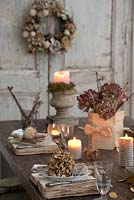 Dried Hydrangea and vintage book table and place setting with candles and 