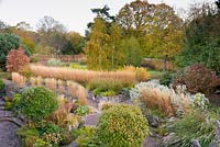 Aerial view of terraced garden with autumn colour at Barn House, Chepstow, UK.