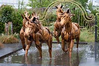 The four horses charging out from the metal gates in 'Revelation' at BBC Gardeners World Live 2019