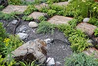 Rough stepping stones in the Through Your Eyes garden, designed by Lawerence Roberts and William Roobrouck, sponsored by Kebony, CED Stone Group, RandG Metal Products at RHS Hampton Court Garden Festival, 2019.