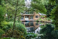 Haddon Lake House, a contemporary Japanese-influenced 'boat house' with decks over a half-acre historic lake. uniting architecture with landscape.