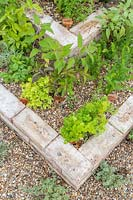 Detail of tiered brick herb garden.