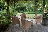 Patio area with outdoor furniture in the Garden of the Auberge de Launay, near Amboise, Loire Valley, France