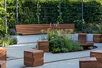 A relaxed seating area within a community space dedicated to physical and mental wellbeing. Crest Nicholson Livewell Garden, designed by Aleksandra Bartczak, RHS Hampton Court Palace Garden Festival, 2019.