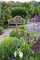 Seating area and colourful flowerbeds in The Art and Nature of a Port Sunlight Garden, Tatton Flower Show 2019