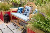 Colourful bench in Petrus' Paradise by Rachael Bennion with Petrus and volunteers RHS Tatton Flower Show 2019