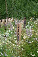 Habitat houses in a wildflower meadow - The BBC Springwatch Garden, RHS Hampton Court Palace Flower Festival 2019