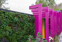 Pink walkway through to classroom with a living wall - The Montessori Centenary Children's Garden, RHS Chelsea Flower Show 2019