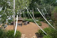 Cultiver les Reves, Grow Your Dreams, Festival International des Jardins 2019, Domaine de Chaumont sur Loire, France. Wishing trees and a tree of life, bearing white ribbons, the symbol of purification in the Old Testament.
