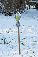 Bird scarer in the snow in late February. The Old Rectory, Suffolk, UK