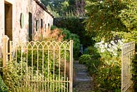 Gate into the Walled Garden at Broadwoodside, Gifford, East Lothian in Scotland.