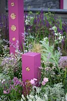 Towering pink insect hotels in the Contemporary Bee and Butterfly Garden at BBC Gardener's World Live 2017