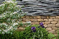Drystone wall with bicycle wheel rims -The 'Tour De Yorkshire' Garden - RHS Chelsea Flower Show 2014 -Sponsor: Yorkshire.com.