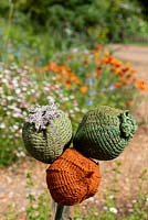 Hand knitted poppy seedheads
