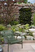 Dry stone wall with moss mounds in the 'Elements of Sheffield' garden at the RHS Chatsworth Flower Show 2019.
