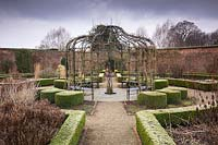 View over The Walled Garden, with metal gazebo and central 'Tree of Life', Ygdrassil - the Norwegian World Tree. Littlethorpe Manor, Yorkshire, UK. Designed by Eddie Harland.