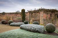 Pergola, clipped Lavendar and spheres of English Yew at Littlethorpe Manor, Yorkshire UK. Designed by Eddie Harland.