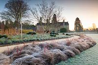 View of the Winter Garden and sweeping path at Wakehurst, West Sussex, UK.