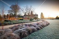 View of the Winter Garden and sweeping path at Wakehurst, West Sussex, UK