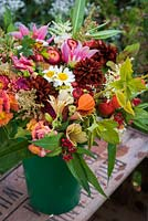 Bouquet of cut flower stems including: Dahlia, Alstroemeria, Chrysanthemum, Physalis, Antirrhinum and hedgerow plants
