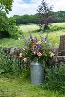A milk churn filled with flowers grown at Pam Moseley's flower farm, Quirky Flowers.
