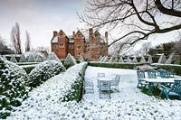Box hedges and pyramids covered in snow at Beckley Park, Oxfordshire, UK.