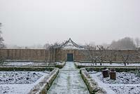 Box hedging providing structure in winter, with central pergola and old Apple trees beyond.