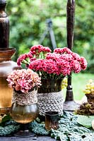 Vases with hydrangea and dianthus.
