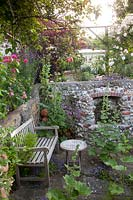 Small sunken walled folly with wooden seat