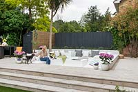 Sunken seating surrounded with wooden decking.