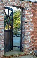 Wooden gate in brick wall.