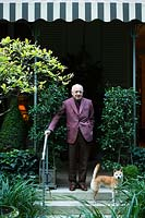 Mr Pierre Berge in his garden. Paris. France