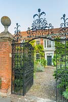 Manor House with wrought iron gateway and cobble front path