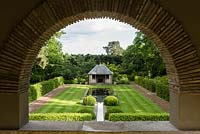 View of the Tranquility Pond and Loggia through the arch of the Thunder House.