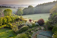View over the Vegetable Garden to to the surrounding countryside. Veddw House Garden, Monmouthshire, Wales, UK.