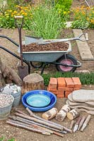 Tools and materials required to construct a sensory garden