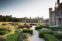 Parterre near castle with low blocks of Taxus - Yew - framing herbaceous perennials including Filipendula venusta 'Rubra', Salvia pratensis 'Indigo' and Veronicastrum virginicum 'Spring Dew'