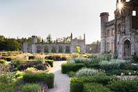 Parterre in front of castle with low blocks of Taxus - Yew - framing herbaceous perennials including Filipendula venusta 'Rubra' and Veronicastrum virginicum 'Spring Dew'