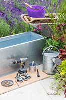 Materials, tools and plants required to make and plant up a zinc trough planter on casters