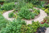 Overview of suburban garden showing circular spiral pattern brick path