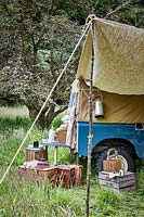 Landrover with awning and picnic setting