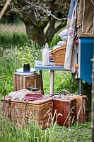 Picnic baskets and vintage luggage at the back of landrover