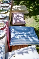 Vintage style cushions on wooden bench